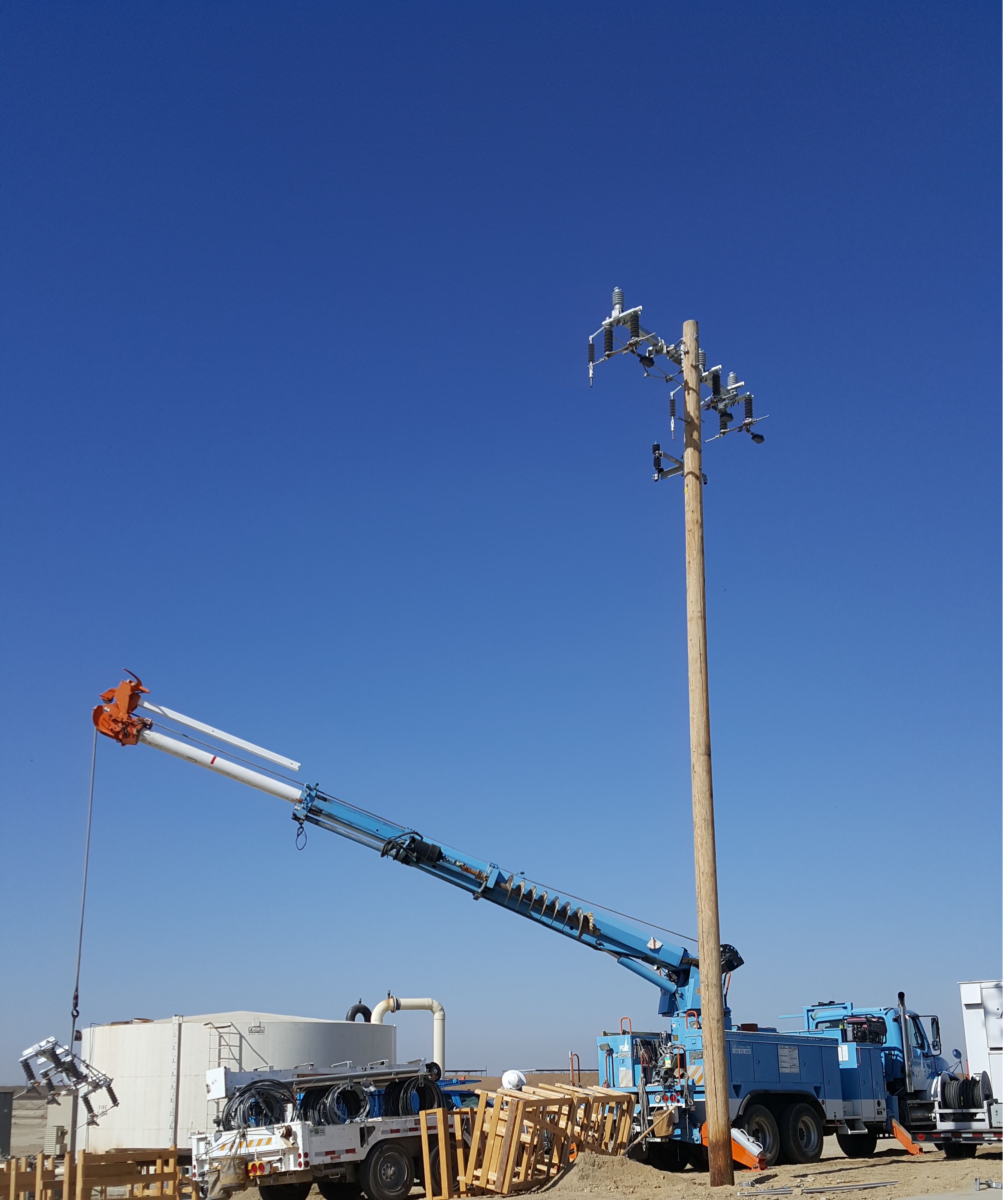 Installing the PG&E electrical pole at the Lakeview Farms Dairy Biogas-to-Electricity Project