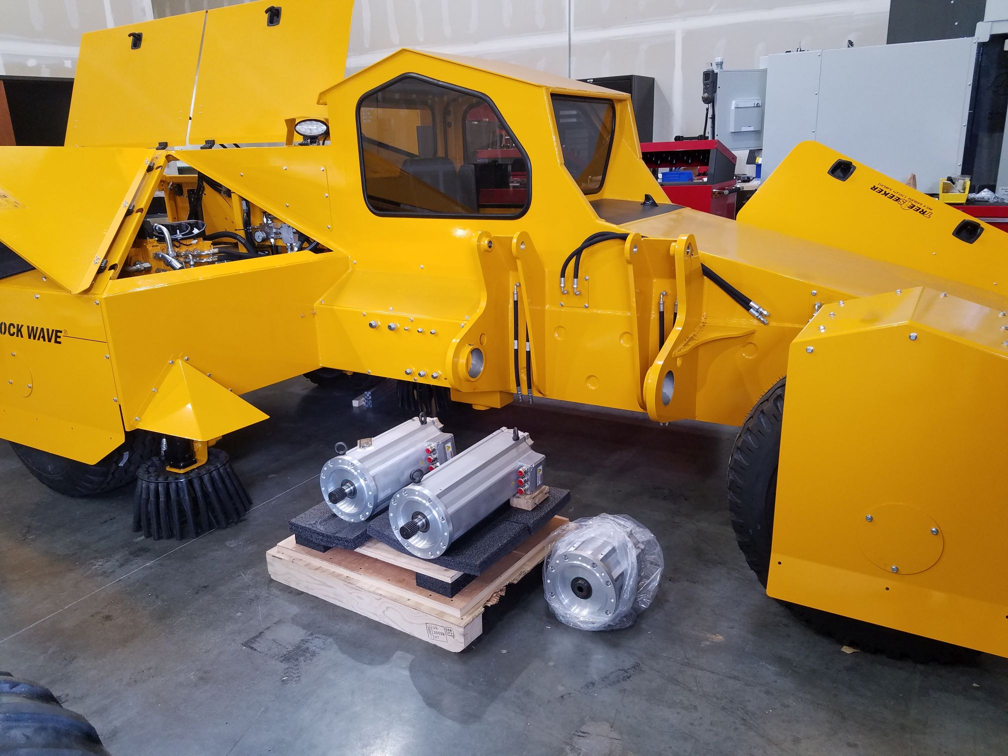 Almond harvester chassis with global vehicle motors in the foreground