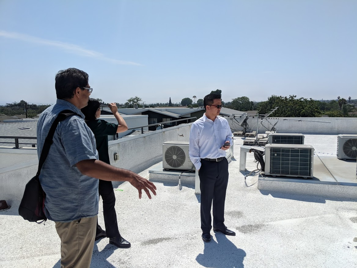 Surveying Exising Rooftop Space with EPRI and LINC Housing Staff at Project Site